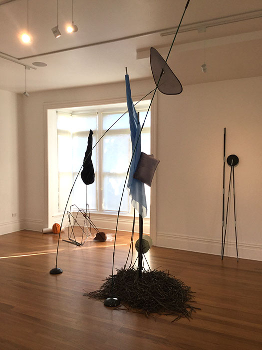 Landscape, 2019, tent poles, lampstand, lamp bases, vinyl, cushions, fruit tree prunings, 3275 x 3300 x 2700mm approx